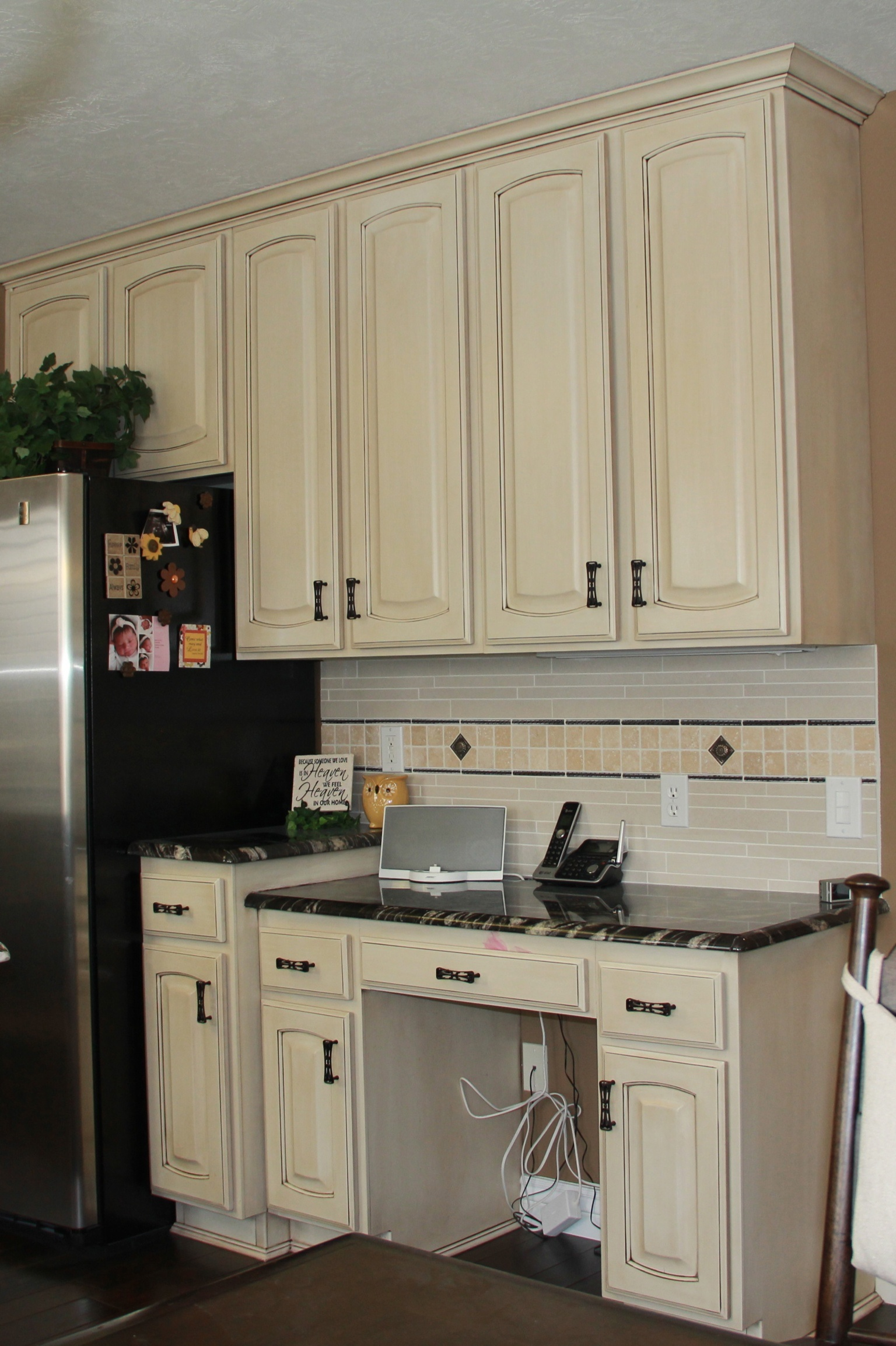 Antique White Kitchen Cabinets with Black Countertops