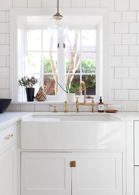 White Kitchens with Antique Brass Hardware