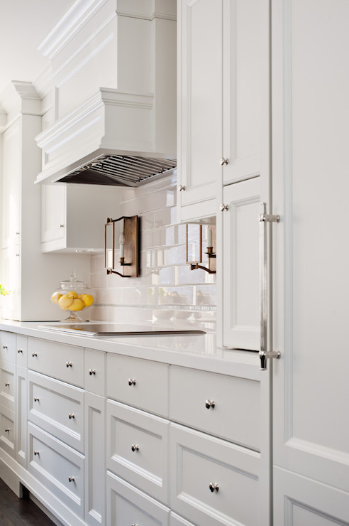 Copper Range Hood with White Cabinets