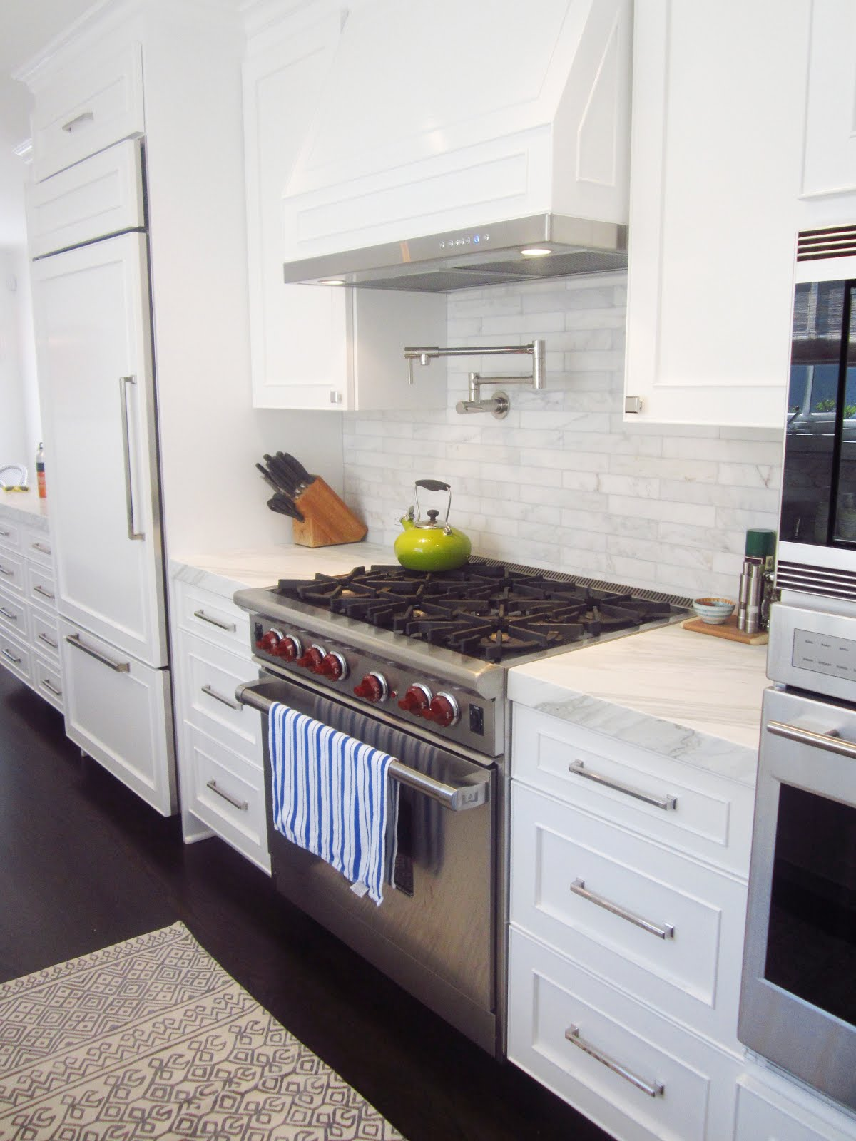 White Kitchen with Stainless Steel Stove