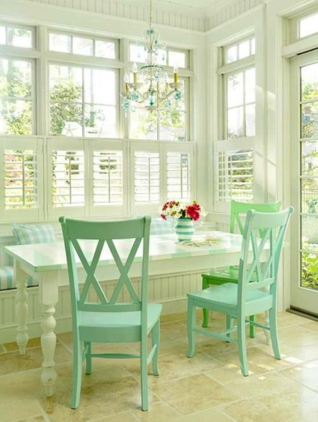 White Table with Colored Chairs